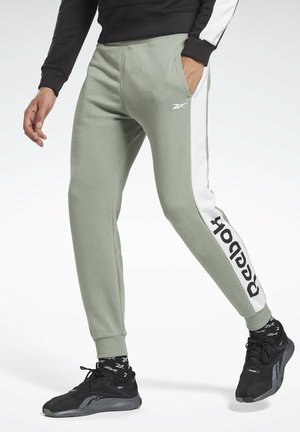 TRAINING ESSENTIALS LINEAR LOGO JOGGERS - Tracksuit bottoms - green