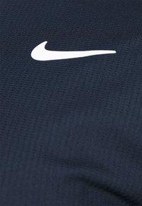 Nike Performance - T-shirt basic - obsidian/white - 5