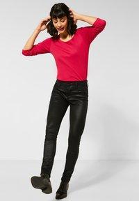 Street One - MIT COATING - Jeans Skinny Fit - schwarz - 1