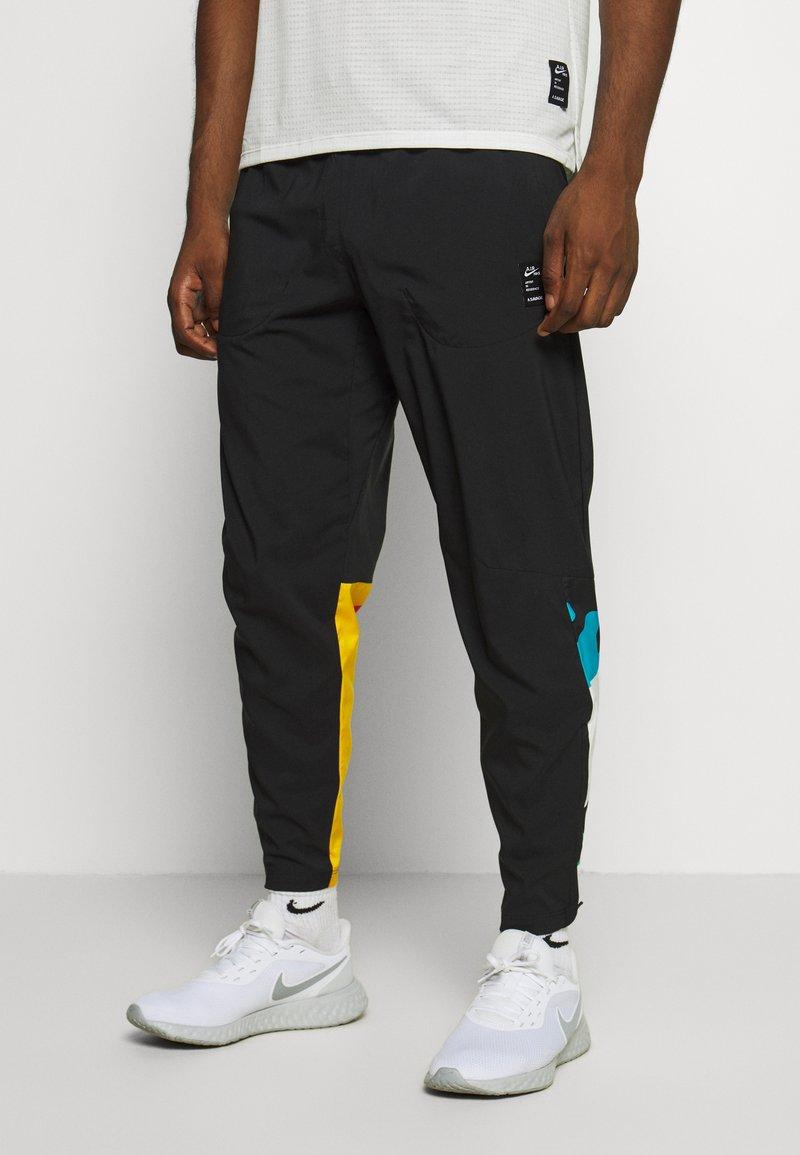 Nike Performance - PANT ART - Träningsbyxor - black