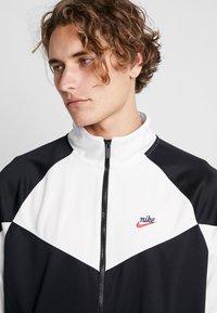Nike Sportswear - Kurtka sportowa - black/summit white - 4