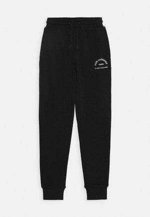 BOTTOMS - Teplákové kalhoty - black