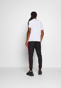 Glorious Gangsta - ALANIS JOGGERS - Tracksuit bottoms - black - 2