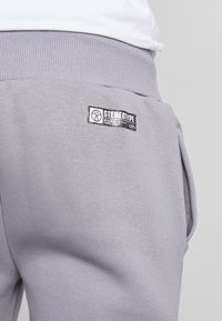 STEREOTYPE - Tracksuit bottoms - grey - 5