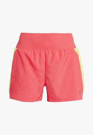 Sports shorts - laser pink/sour yuzu
