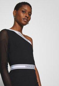 Calvin Klein Jeans - ASYMM MILANO LOGO FITTED DRESS - Shift dress - black - 4