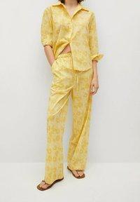 Mango - Trousers - amarillo - 0