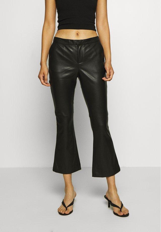 CORNELIA TROUSERS - Pantaloni di pelle - black