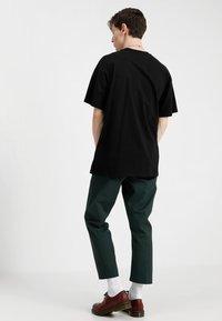 Carhartt WIP - AMERICAN SCRIPT  - Basic T-shirt - black - 2