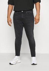 Tommy Jeans Plus - Slim fit jeans - black denim - 0