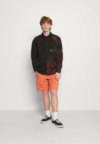 Nike Sportswear - REVIVAL - Shorts - light sienna/dark smoke grey - 1