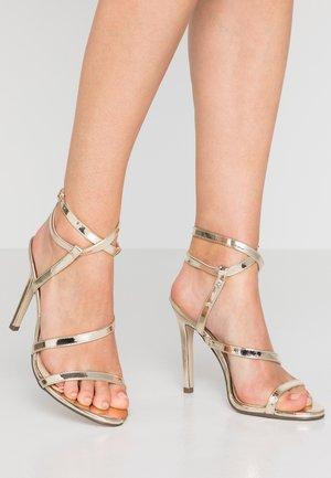 AIMEE - Sandály na vysokém podpatku - gold