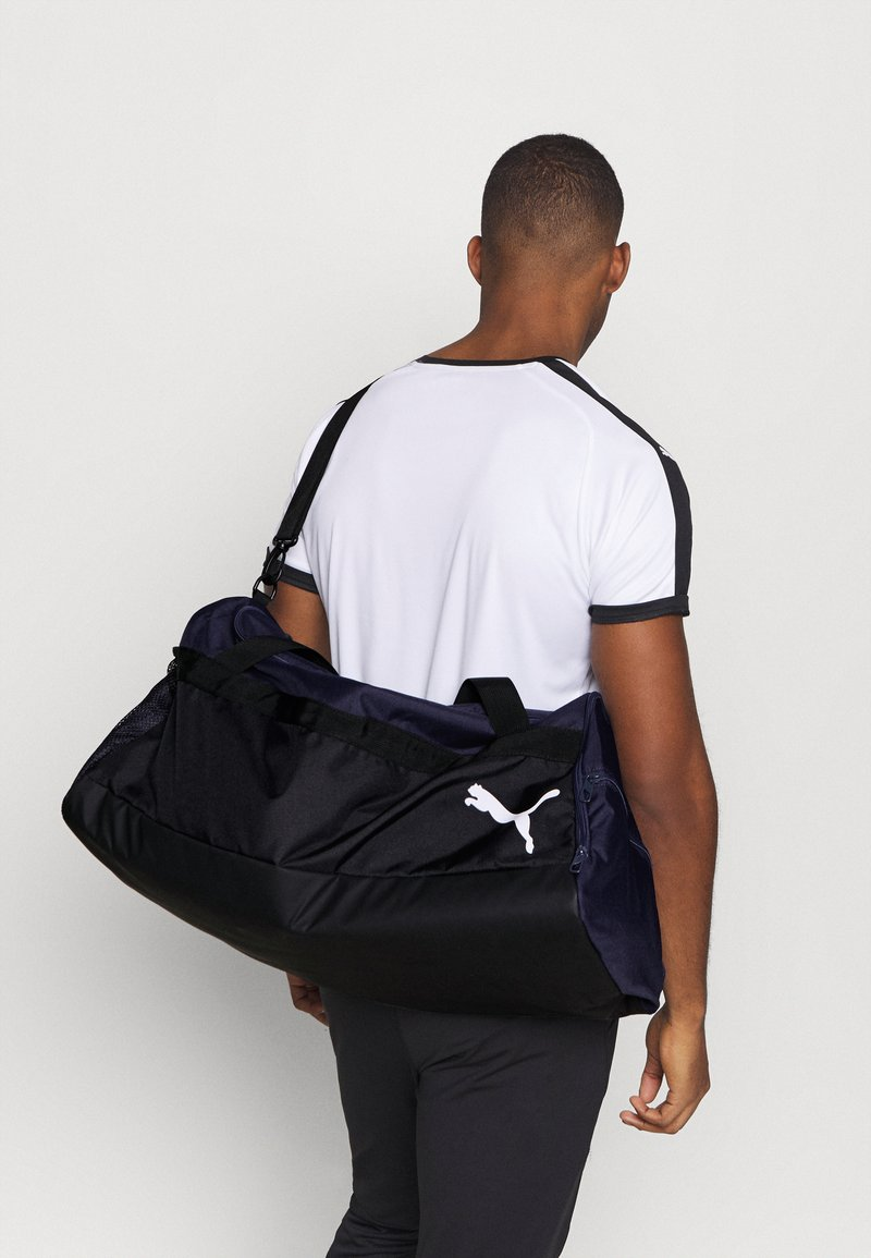 Puma - TEAMGOAL TEAMBAG - Sports bag - peacoat/black