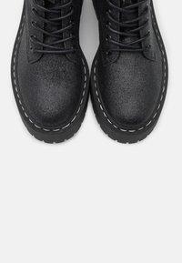 Steve Madden - SKYLAR - Platform ankle boots - black - 5