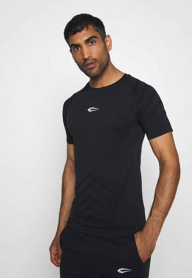 SEAMLESS SPYDER - T-shirt z nadrukiem - schwarz