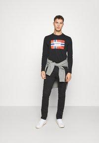 Napapijri - MOTO WINT - Cargo trousers - black - 1