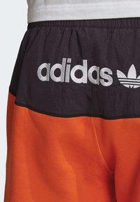 adidas Originals - ADVENTURE FIELD JOGGERS - Tracksuit bottoms - orange - 6