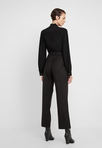 McQ Alexander McQueen - Trousers - black/red - 2
