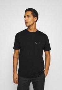 Diesel - T-JUST-SLITS-A30 MAGLIETTA UNISEX - Print T-shirt - black/black - 4