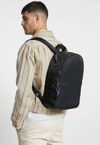 Calvin Klein - TRAIL ROUND BACKPACK - Rucksack - black - 1