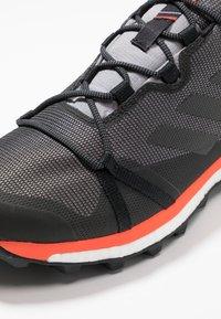 adidas Performance - TERREX SKYCHASER LT GTX - Trail running shoes - grey three/core black/active orange - 6