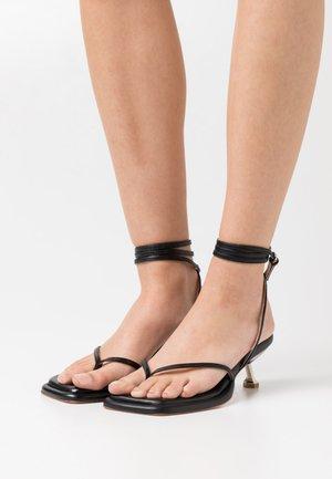 SAIGON - T-bar sandals - black