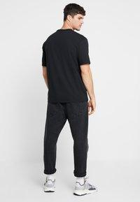 adidas Originals - REVEAL YOUR VOICE TEE - Basic T-shirt - black - 2