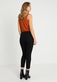 s.Oliver - SHAPE ANKLE - Trousers - black - 2
