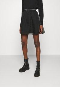 Calvin Klein Jeans - LOGO WAISTBAND SKIRT - A-line skirt - black - 0