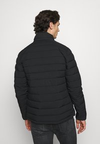 Abercrombie & Fitch - PUFFER JACKET - Light jacket - black - 3