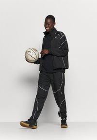 Nike Performance - FLY JACKET - Chaqueta de entrenamiento - black/white - 1