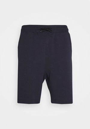 DOSHI - Tracksuit bottoms - dark blue