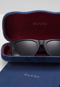 Gucci - Occhiali da sole - black/green - 2