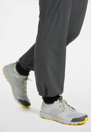 L.I.M LOW - Trail running shoes - stone grey/signal yellow