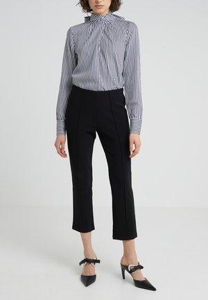 VIGGIE - Trousers - black