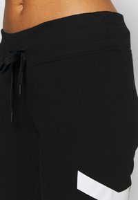 DKNY - EXPLODED LOGO CUFFED - Tracksuit bottoms - black - 5