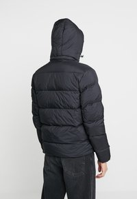 Calvin Klein Jeans - HOODED DOWN PUFFER  - Winter jacket - black - 2