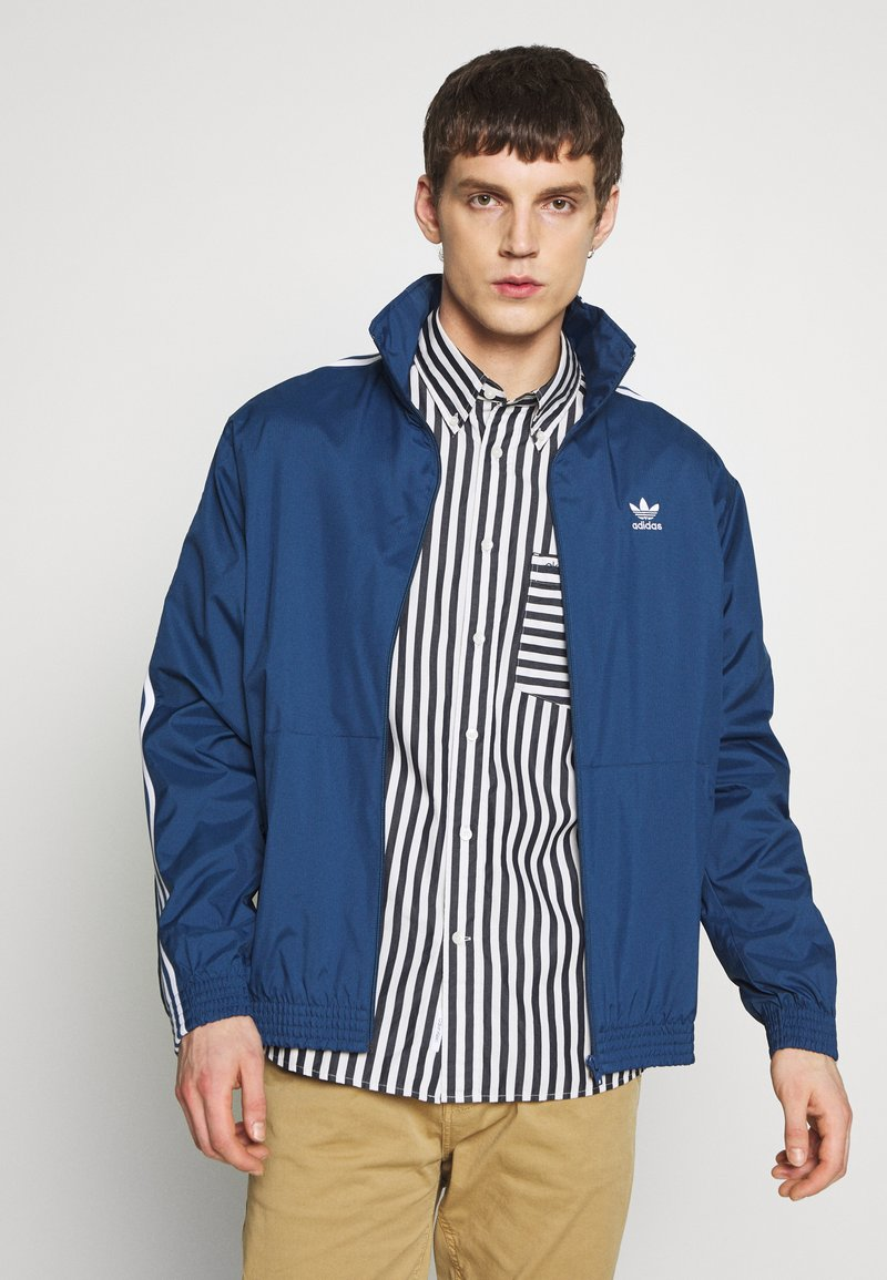 adidas Originals - LOCK UP ADICOLOR SPORT INSPIRED TRACK TOP - Training jacket - blue