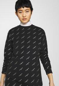 Calvin Klein Jeans - LOGO DRESS - Day dress - black - 3