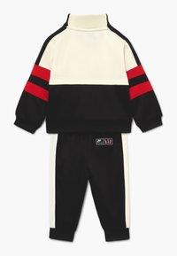 Nike Sportswear - AIR SET - Tracksuit - black/university red - 1