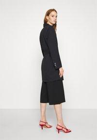Gestuz - FLEUR - Short coat - black - 2