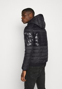 Calvin Klein - HOODED JACKET - Light jacket - black - 2