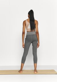 Puma - STUDIO JOGGER - Tracksuit bottoms - charcoal gray heather - 2