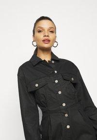 Missguided Petite - COATED CINCHED WAIST BOILERSUIT - Jumpsuit - black - 3