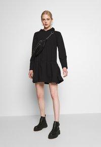 NA-KD - GATHERED HOODIE DRESS - Day dress - black - 1
