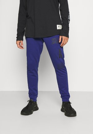 RIVAL - Tracksuit bottoms - regal