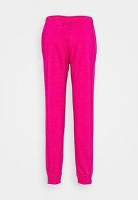 Nike Sportswear - Tracksuit bottoms - fireberry/white - 7