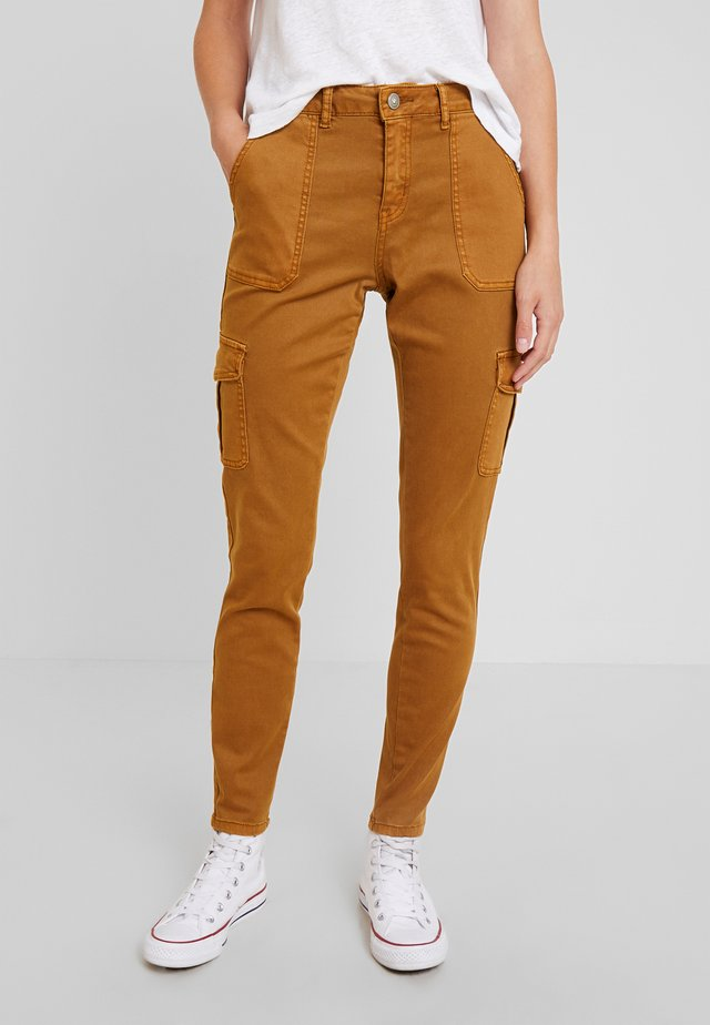 ANNIE PANTS BAIILY - Trousers - bronzed