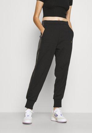 CUFFED TREFOIL MOMENTS - Spodnie treningowe - black