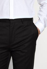 HUGO - HARTLEY - Suit trousers - black - 4